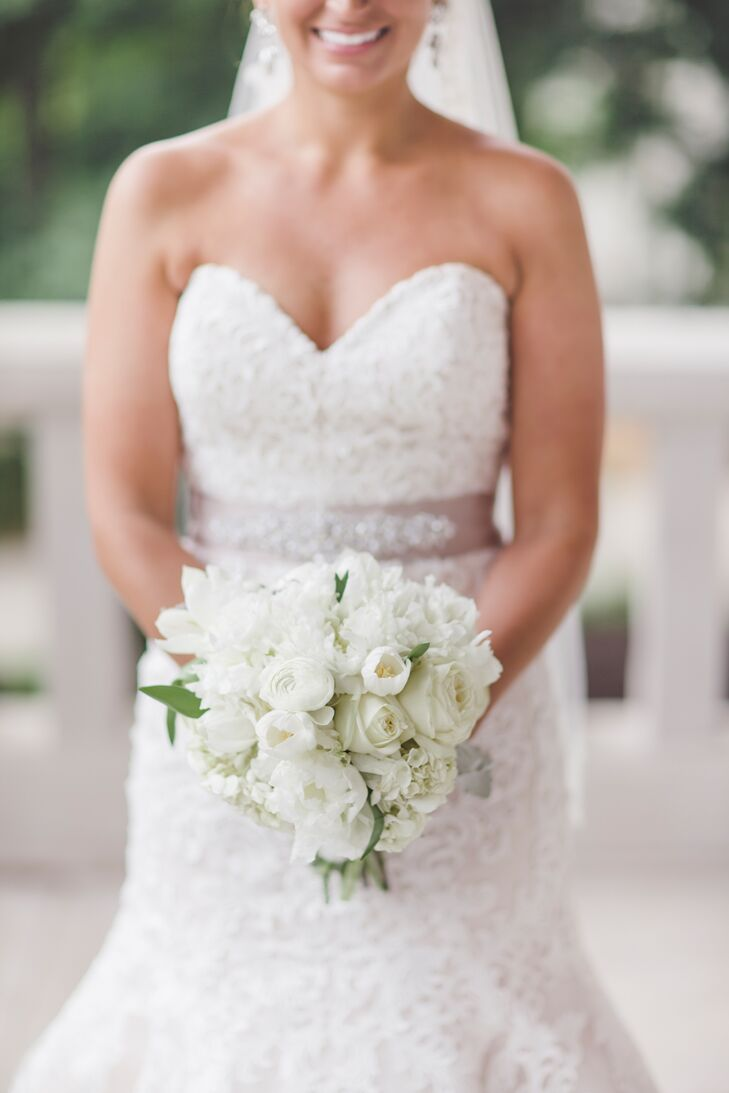 The ivory bridal bouquet was made up of peonies, roses and hydrangeas.
