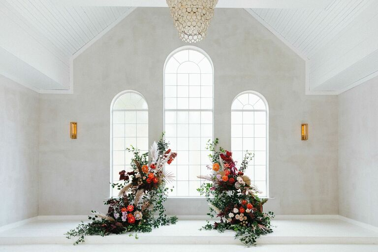 Altar with colorful deconstructed arch floral arrangement