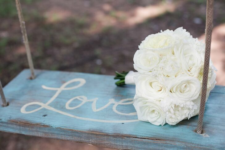 Nikki carried white roses and peonies for a lush, classic bridal bouquet.