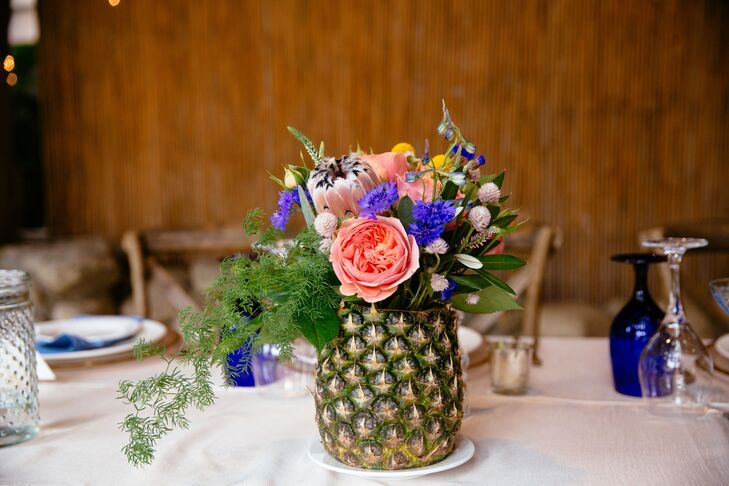 Pineapples were mixed in with the floral arrangements, perfectly reflecting the island theme and Mallory and Richie's former home in Pineapple Bay.