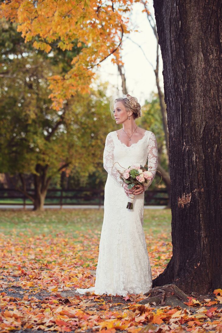 """I wanted a wedding dress that was romantic and reminiscent of Victorian weddings,"" Stephanie says. She wore a solid-lace form-fitting gown with long sleeves by Olvi's Trends. For the ceremony, she paired her dress with a birdcage veil."