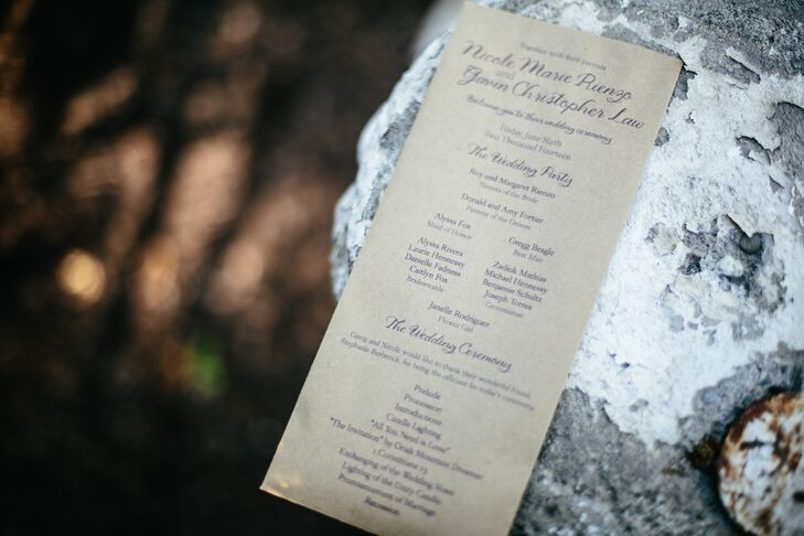 Kraft paper bags boasted the ceremony's program, printed in the signature plum ink. Guests reached inside the bags when recessional time came to shower the newlyweds.