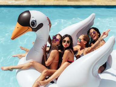 women friends on swan pool float bachelorette party
