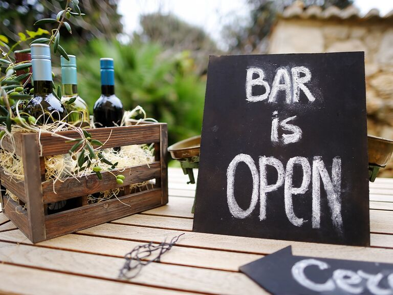 wine bottles with bar is open sign