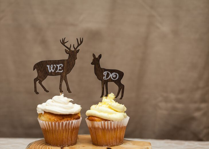 Instead of a traditional wedding cake, Jenn and Zach enjoyed two white cupcakes topped with deer to match their rustic mountain wedding.