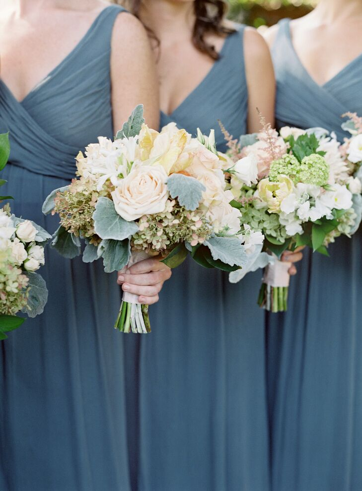 All eight bridesmaids carried classic bunches of Juliet roses and hydrangeas (Elizabeth's favorite) along with ivory garden roses, dahlias, parrot tulips and sweet peas.