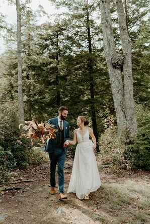Bohemian Couple Wearing A-Line Wedding Dress and Dark Blue Suit