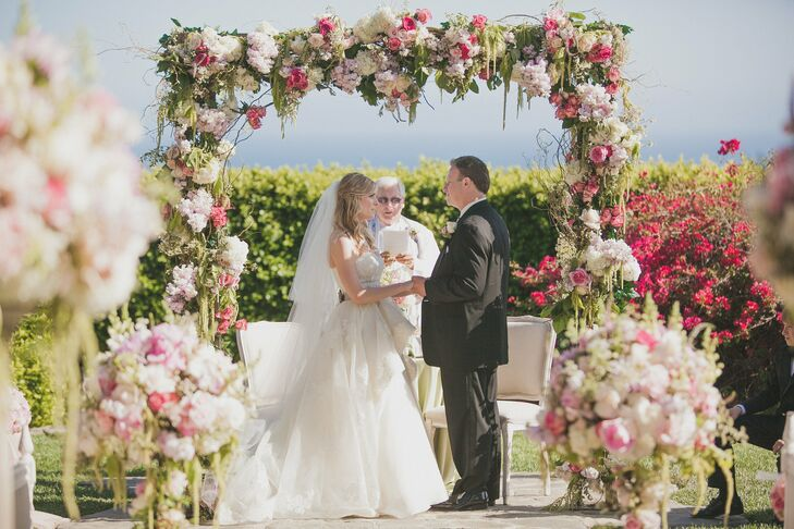 Lush floral decor surrounded the couple as they said their vows.