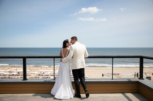 Beach Couple with Modern Wedding Dress and White Suit Jacket