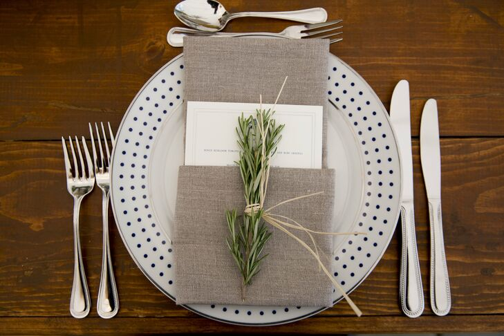 Navy blue polka dot plates and natural linen napkins with square menus were a fun but elegant look.