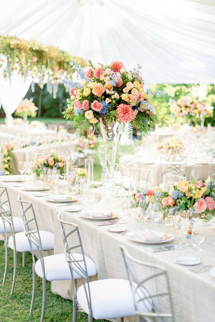 Dining Tables with Tall Floral Centerpieces and Ivory Linens