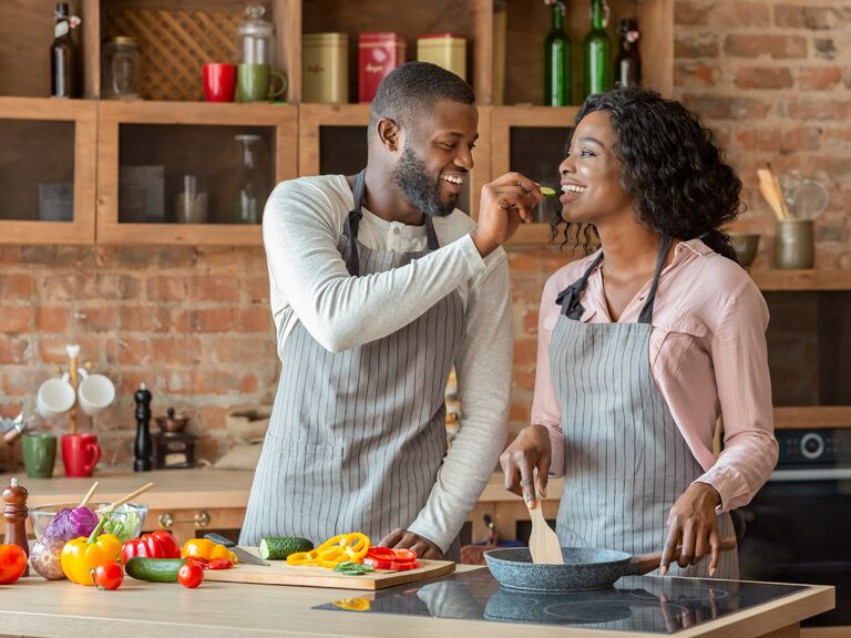 Happy couple cooking together in the kitchen