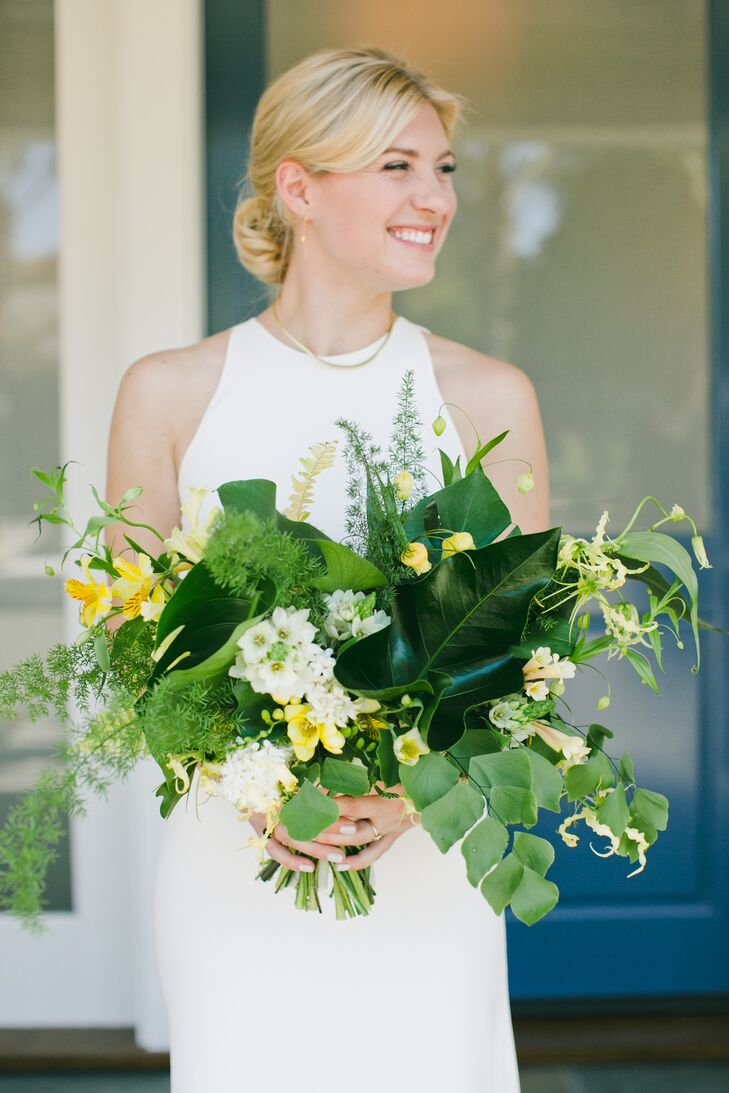 Hawthorn Flower Studio designed Carolyn's leafy green bouquet, which had touches of yellow blossoms.