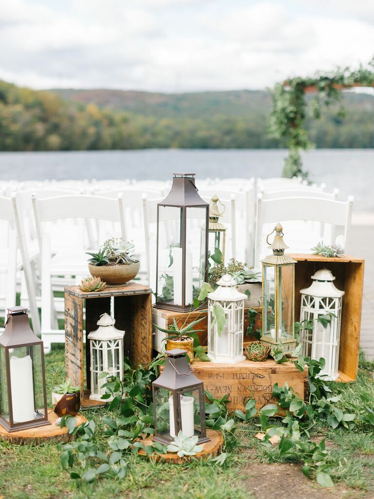 Cluster of distressed antique lanterns as wedding aisle decorations