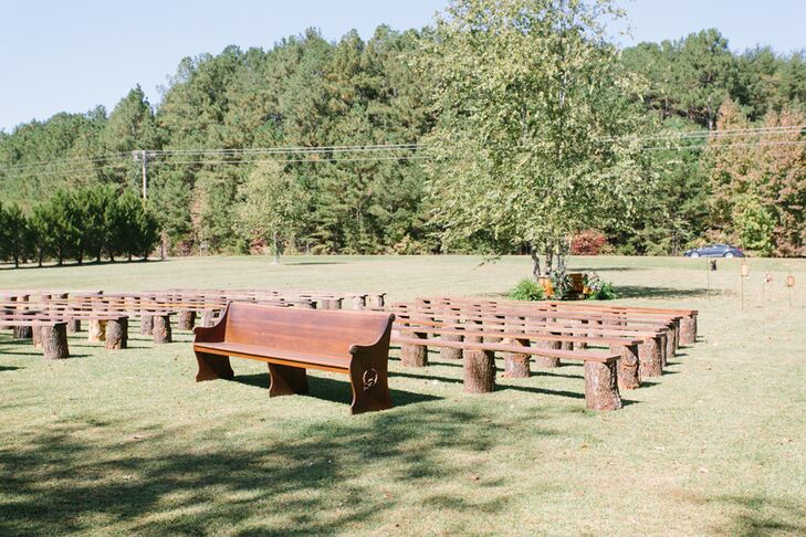 Megan's family built benches out of stumps and wooden planks that served as guest seating for the ceremony on the large lawn of the lake house in Double Springs, Alabama.