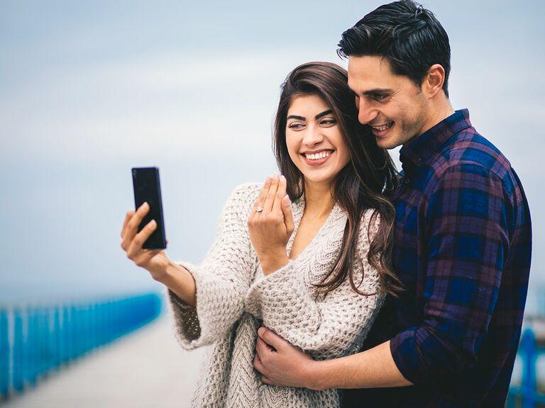 couple taking engagement selfie