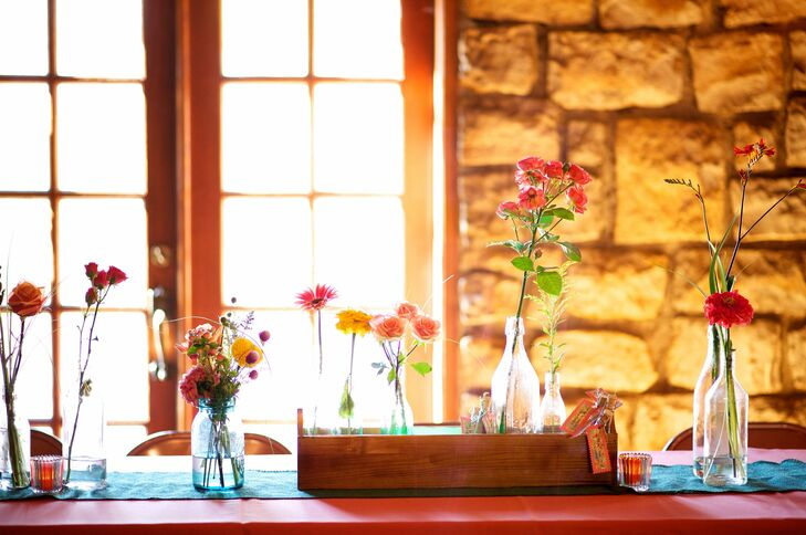 The centerpieces featured various wildflowers displayed in wood crates.