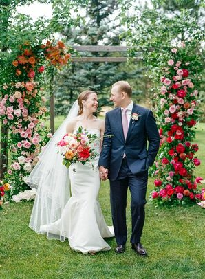 Romantic Couple with Colorful Flower-Covered Wedding Arch