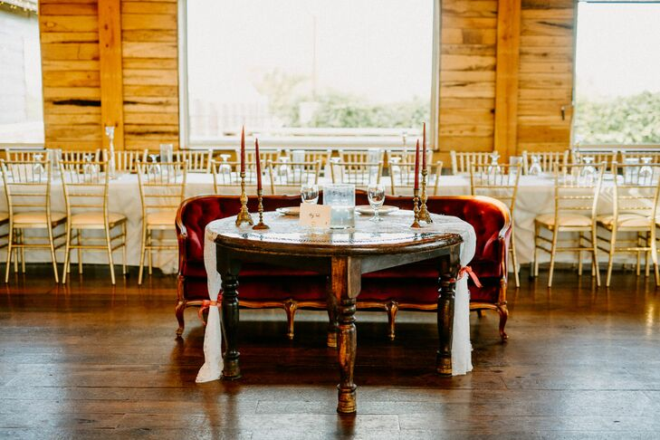 Sweetheart Table with Taper Candles and Red Velvet Couch