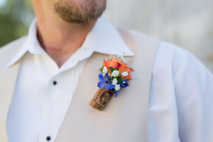 Jeff's boutonniere included orange roses and blue hydrangea stuck in a wine cork.