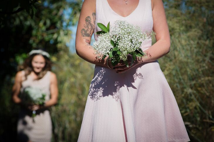 The bridesmaids carried simple and romantic baby's breath bouquets arranged by Sea of Bloom.