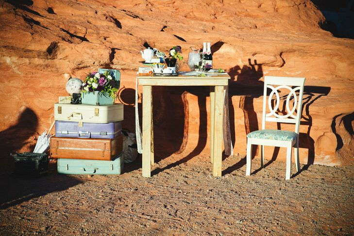To honor Genesis and Oliver's love of travel, event planner Cactus and Lace used stacks of vintage suitcases as side tables and brought in cool vintage chairs for seating.