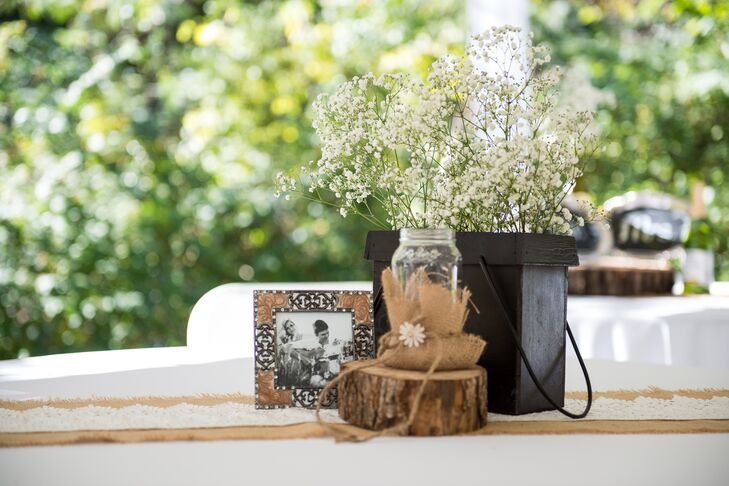 For their rustic affair, the couple worked with Emily's mother to make all of their shabby-chic decor by mixing vintage accents, burlap and baby's breath.