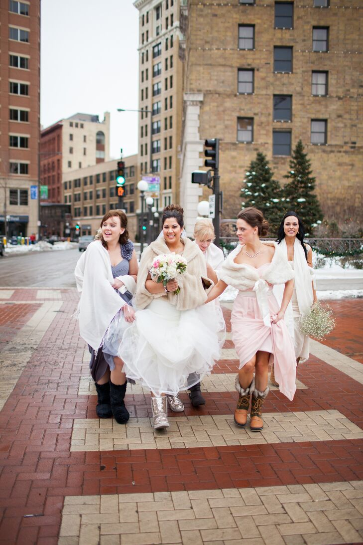 Emily says she didn't even see the mismatched pastel wedding dresses all together until the ceremony. The girls wore Ugg boots and shawls for the trek to the church—changing into more formal heels for the ceremony.