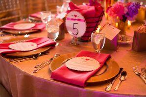 Gold Plates and Fuchsia Linen Napkins