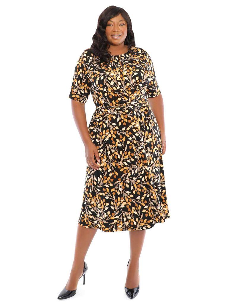 Black and gold leaf-printed midi dress