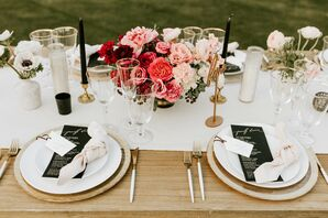 Black and White Dining Table Scheme with Gold Accents and Pink Centerpiece