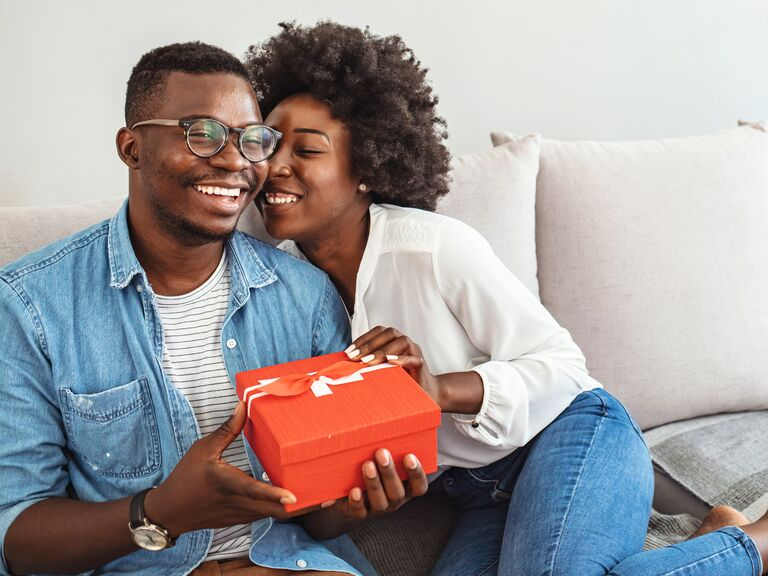 couple holding gift box with bow