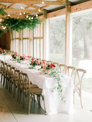 Cross-Back Chairs and Flower-Filled Reception Table