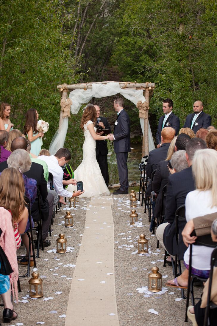 """""""We both enjoy being outdoors and love living in Colorado, so we wanted to make sure our wedding took advantage of the beautiful mountain scenery,"""" Melissa says. The Silverthorne Town Pavilion did just that, the ceremony site affording stunning views of the natural landscape, including the nearby river and mountains."""