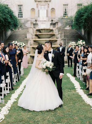 Couple Shares Kiss During Recessional at The Swan House in Atlanta, Georgia