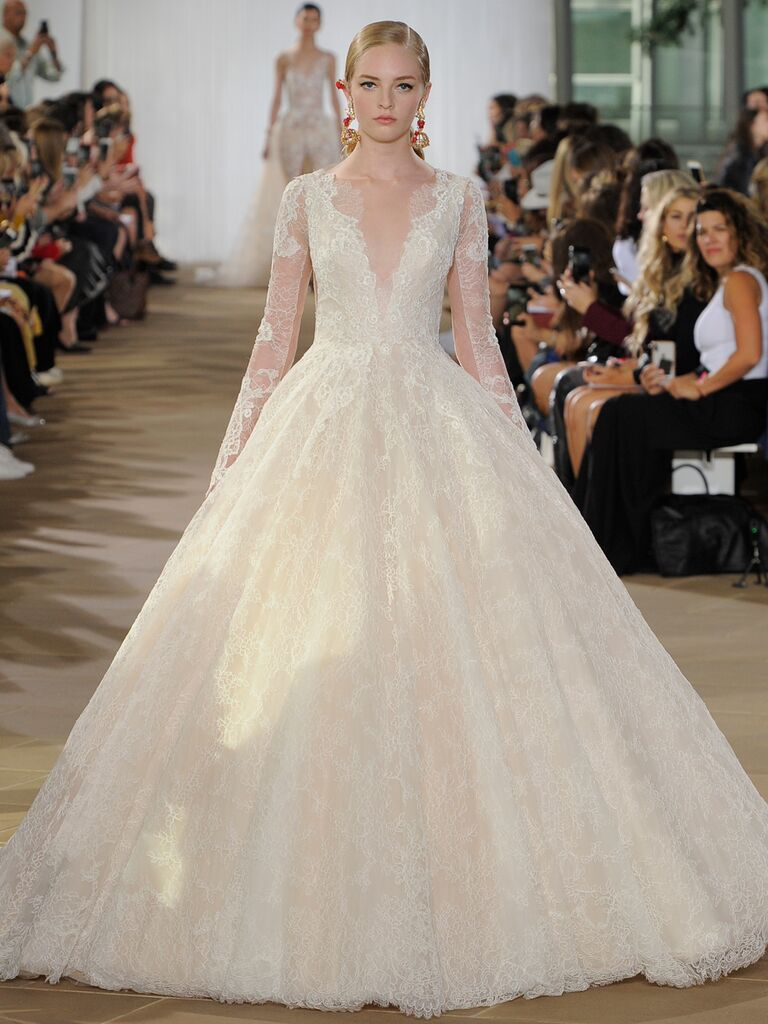 Ines Di Santo Fall 2019 lace wedding dress with a ball gown silhouette, V-neckline and sheer long sleeves
