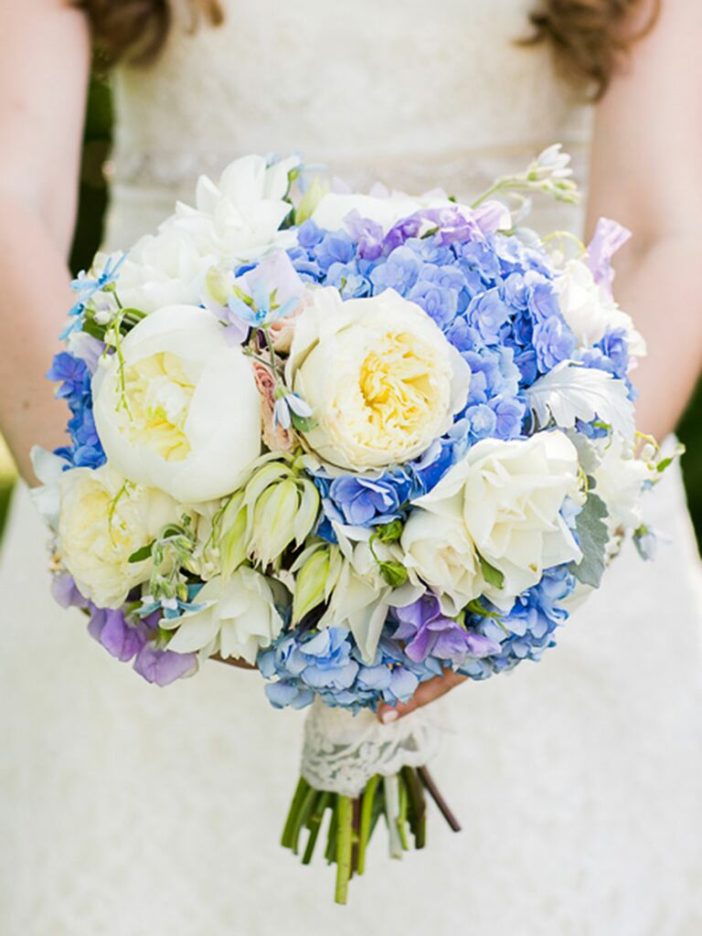 Blue and white wedding bouquet with peonies, roses, irises, tweedia and hydrangeas