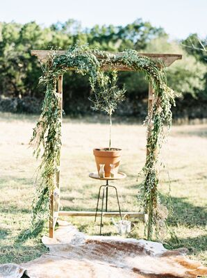 Bohemian Mixed Greenery Arch and Cowhide Rug