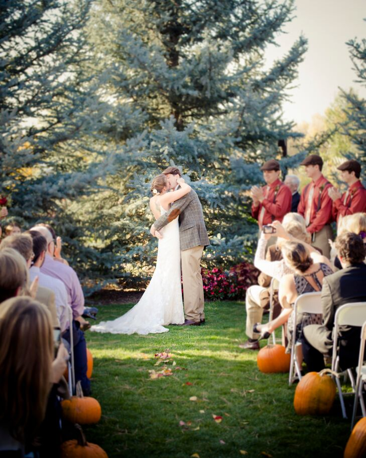Brooklynn and Steve lined their ceremony aisle with orange pumpkins to match the fall wedding theme and match the orange color palette. They also scattered fall leaves down the aisle instead of more traditional rose petals. Loving the naturally gorgeous fall trees and gardens at their venue, they decided to keep decor to a minimum.