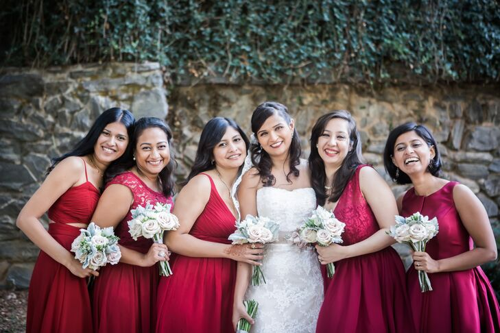 Aparna's bridesmaids wore deep crimson dresses, which matched the groomsmen's maroon ties and boutonnieres.