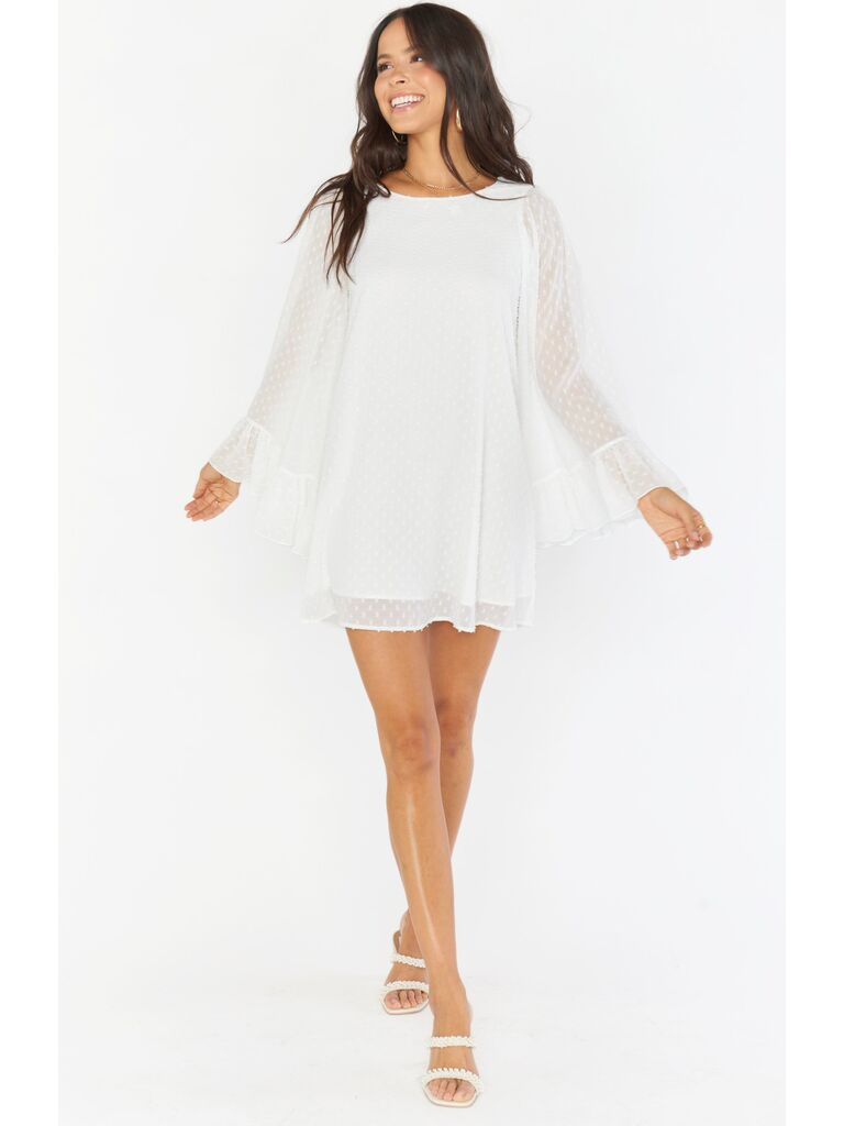 White mini dress with long sleeves and Swiss dots