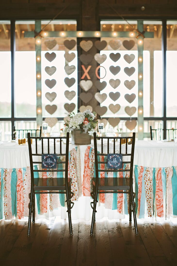 One of the biggest DIY pieces of the couple's reception was the large light up frame of hanging hearts. The hearts were all the notes Chad had written to Hayley in middle school.