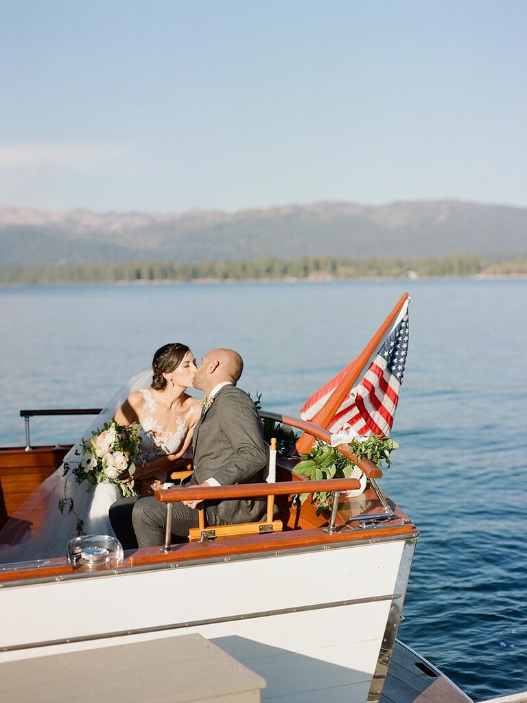 bride and groom kissing in boat