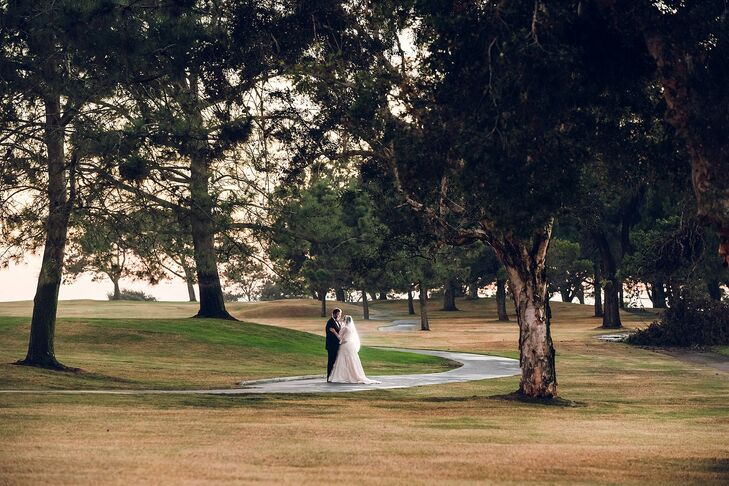 Cassandra and Stephen stood surrounded by the trees at the Lodge at Torrey Pines in San Diego, California, which is known as the site of the 2008 US Open golf championships. They fell in love with the beautiful landscaping, and the helpful staff won them over as well.