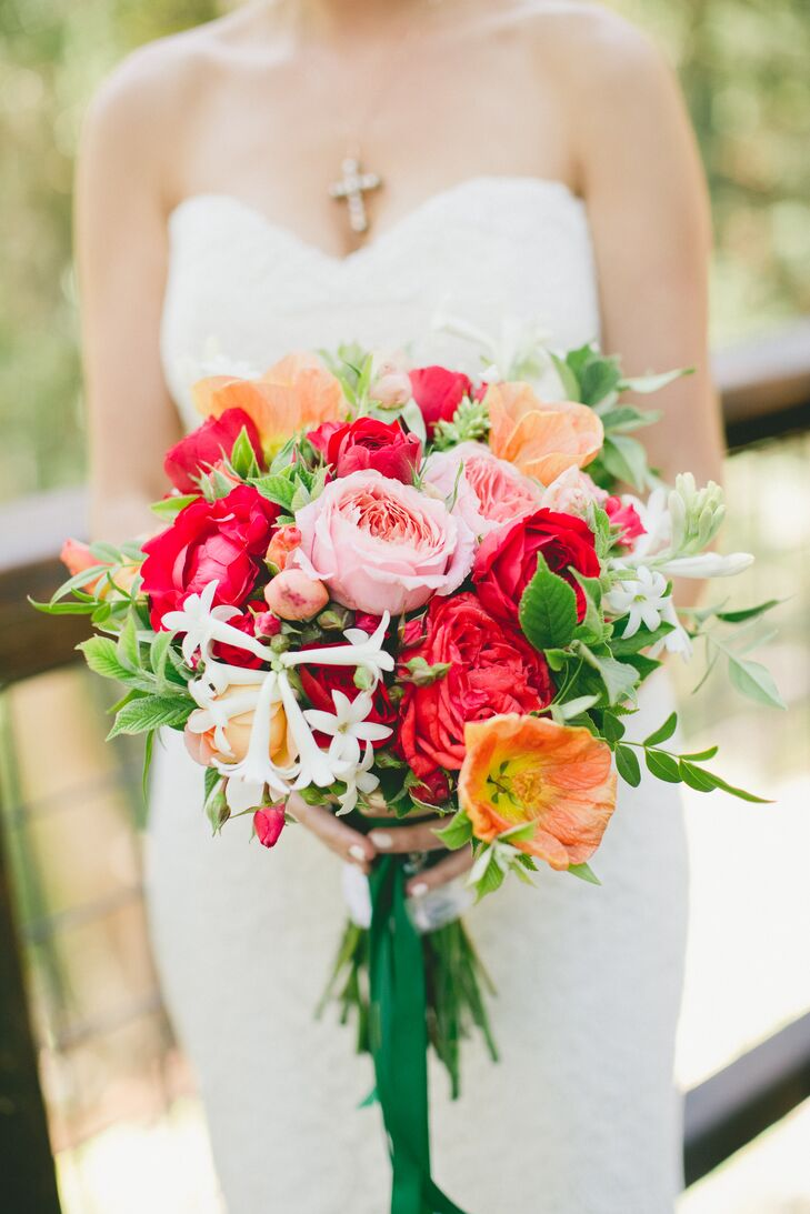 Melanie carried a vibrant bouquet filled with red and peach blooms that included abutilon, garden roses and dahlias.