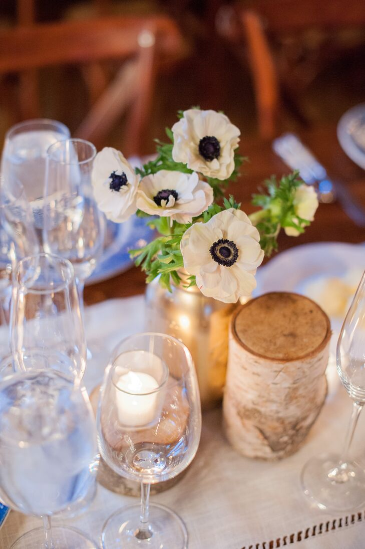 With a venue that exuded country charm, Jill and Donal opted for decor that followed suit. Wooden farm tables were lined with hemstitch linen runners, chinoiserie-inspired dinner plates, ivory inlay flatware, birch accents and pops of gold woven throughout for a hint of understated glamour.