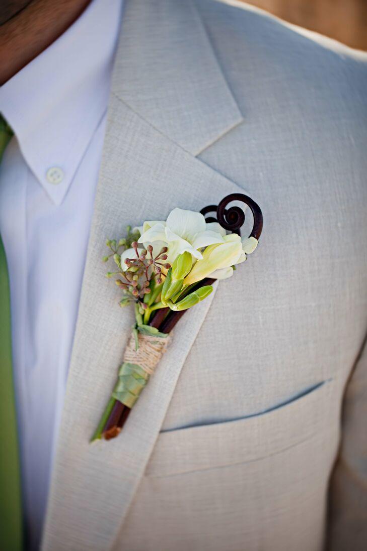 Matt wore white blossoms with a fiddlehead fern stem.