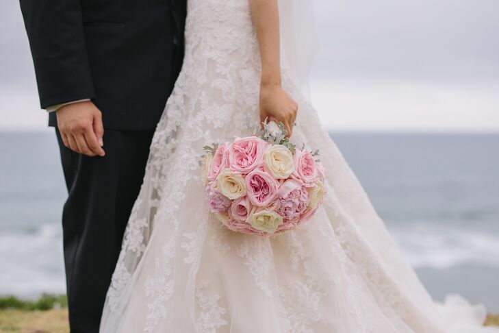 The florist used lush, tight arrangements of garden roses to create a romantic look.