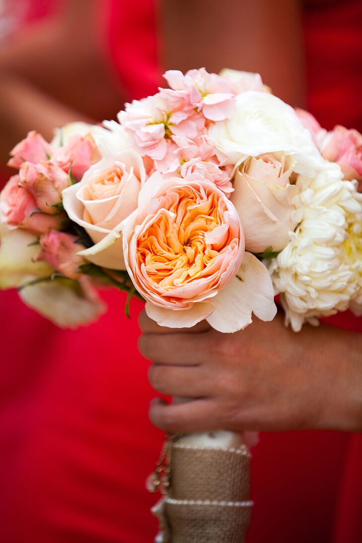 """The girls' flowers were peach and coral flowers with white,"" Veronica says. ""Each of their bouquets had a meaningful charm that we put on together before the wedding."""