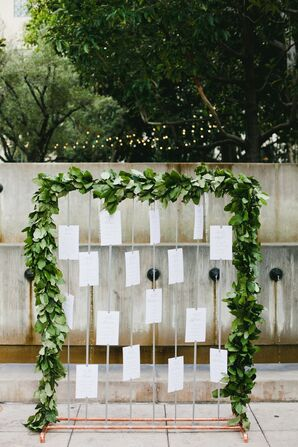 Escort Cards on Greenery-Wrapped Frame